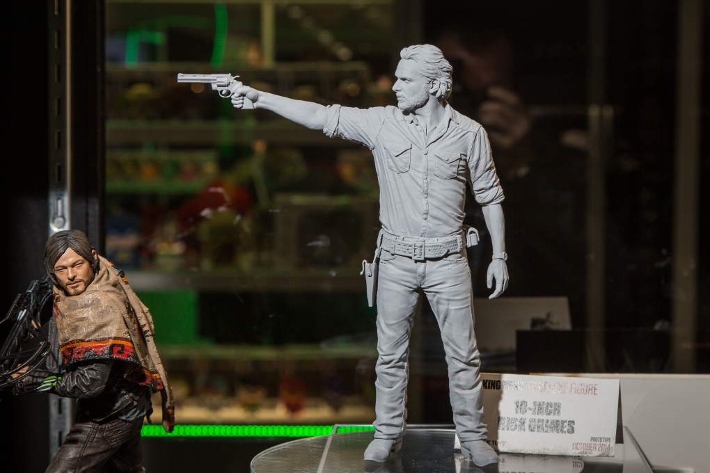 Printed version at toyfair side by side with Daryl's figure.- Body sculpted by Majid Smiley.